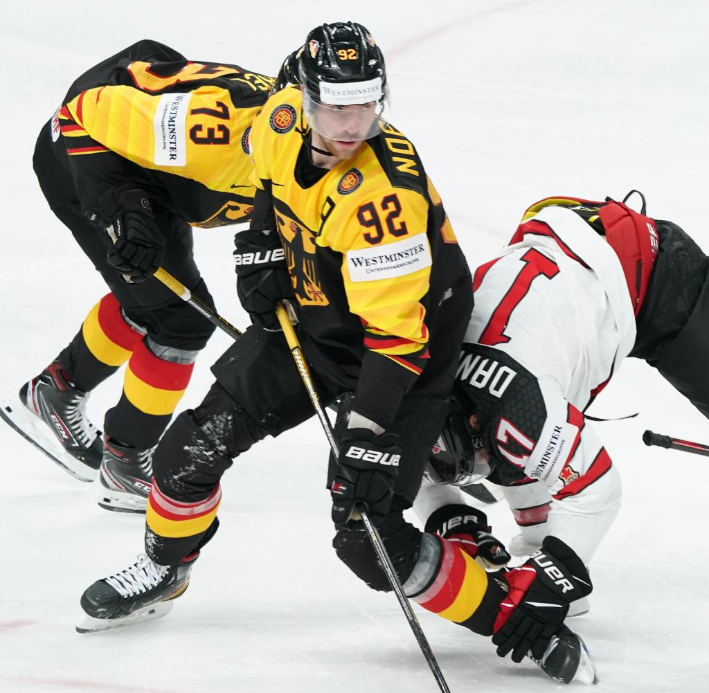 With combined forces, Lucas Rachel (left) and Marcel Noibles fought Canada with Justin Danforth