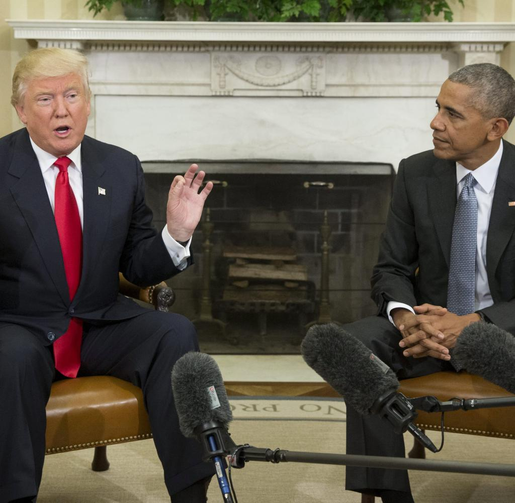Barack Obama (right) hands over to Donald Trump