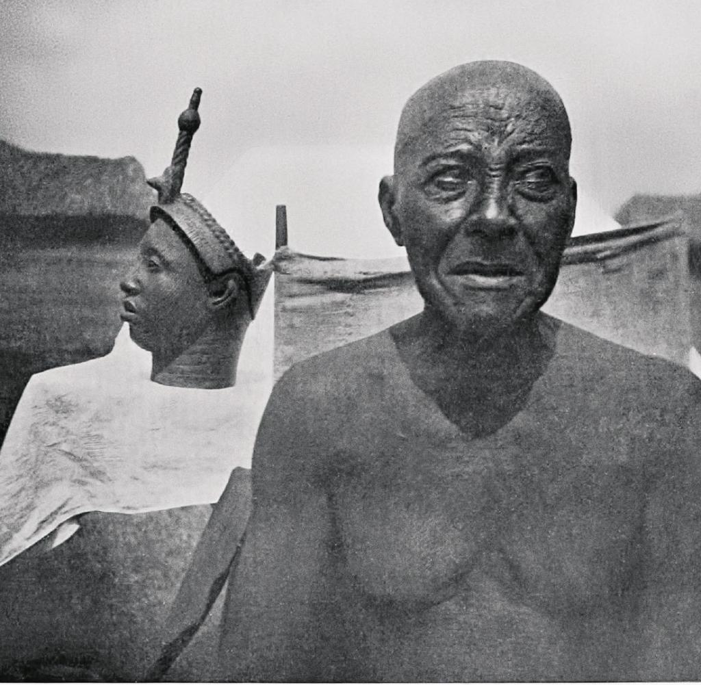 Bust and guardian in Nigeria, photographed by African traveler Leo Frobenius in 1910