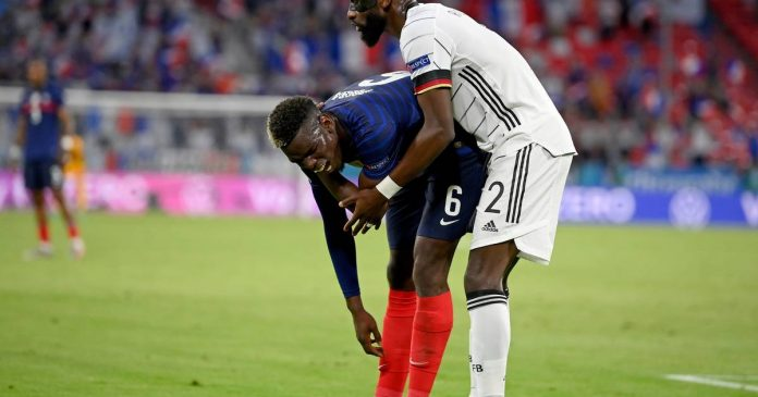 Antonio Rudiger bites Paul Pogba during the match between Germany and France