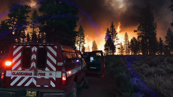 Fires in North America: Firefighters on the Edge of Their Power