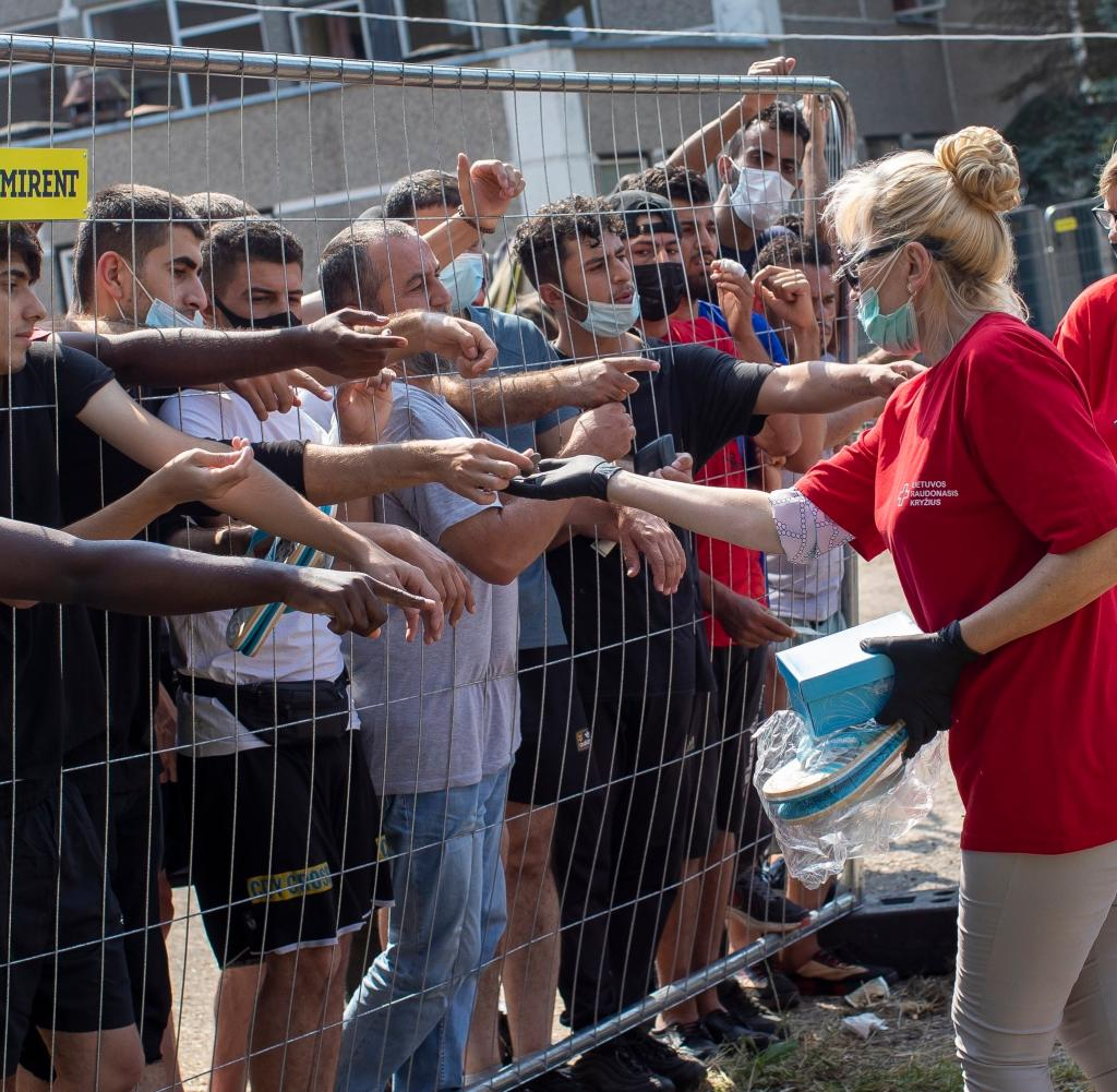 Lithuanians help migrants in a refugee camp in Verbijay