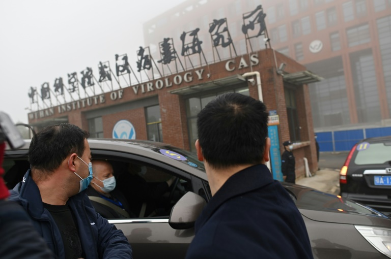 Members of the WHO team working on the origins of Covid-19 arrive at the Institute of Virology in Wuhan, China on February 3, 2021 (AFP / ARCHIVES - HECTOR RETAMAL)