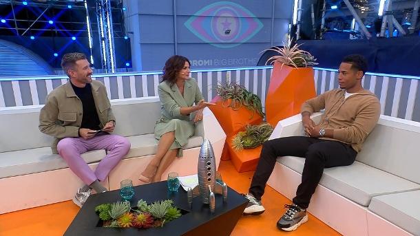 """Brumi's older brother"": Dennis Ugo in conversation with Marilyn Lovin and Jochen Skrupp.  (Source: Saturday 1)"