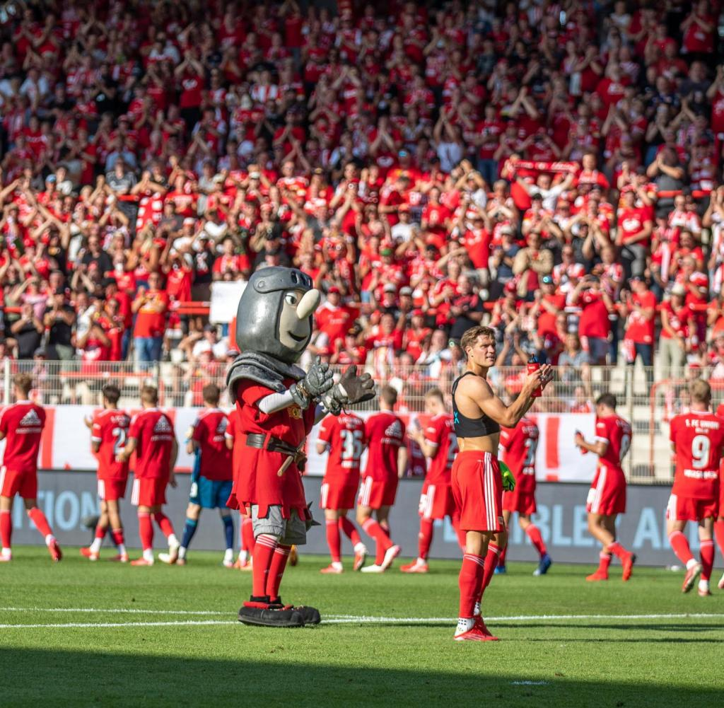 Union Berlin team thanks their loyal fans after the draw against Leverkusen at the start of the season
