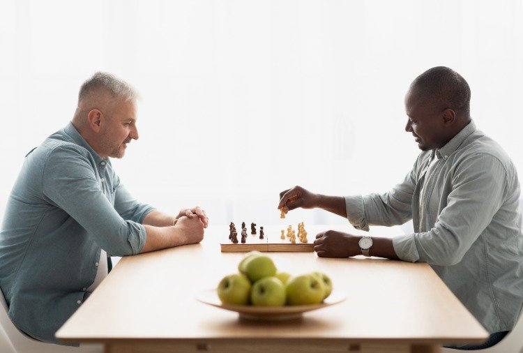 Two men playing chess during the epidemic