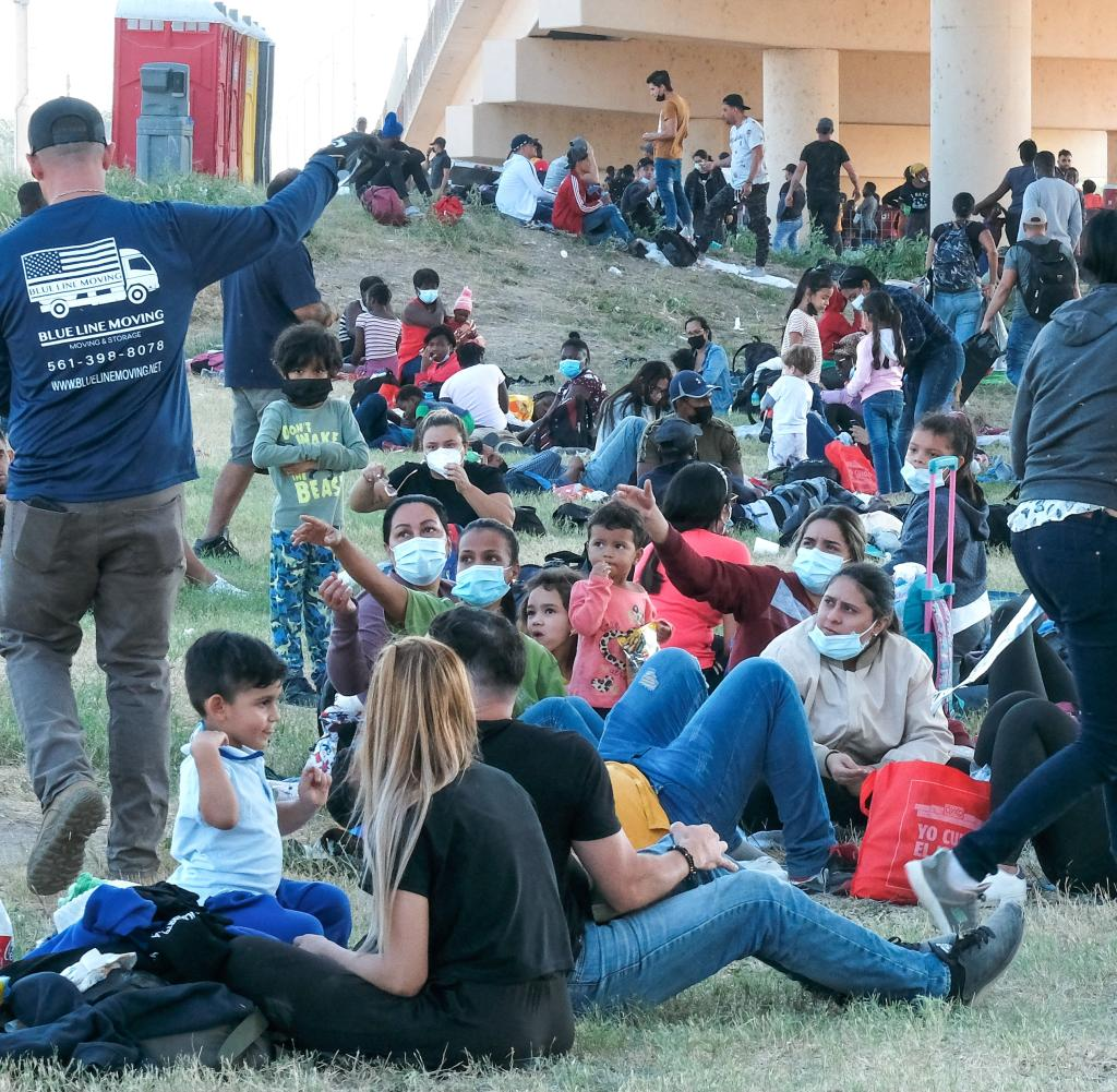 Up to 14,500 people sit under a bridge near the Rio Grande