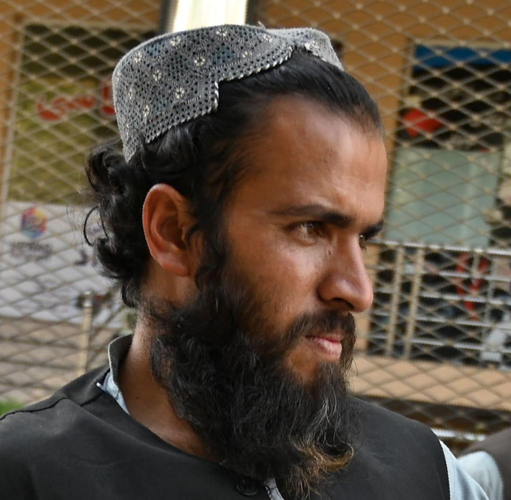 At the beginning of October, a Taliban fighter guarded a corridor in front of an office in Kabul responsible for issuing passports.