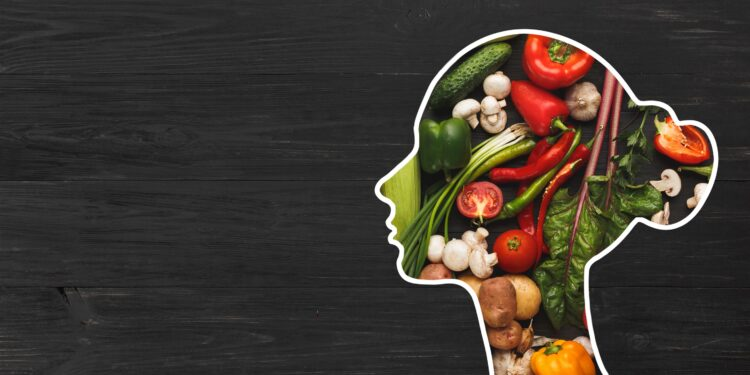 A woman's head silhouette filled with healthy fruits and vegetables.